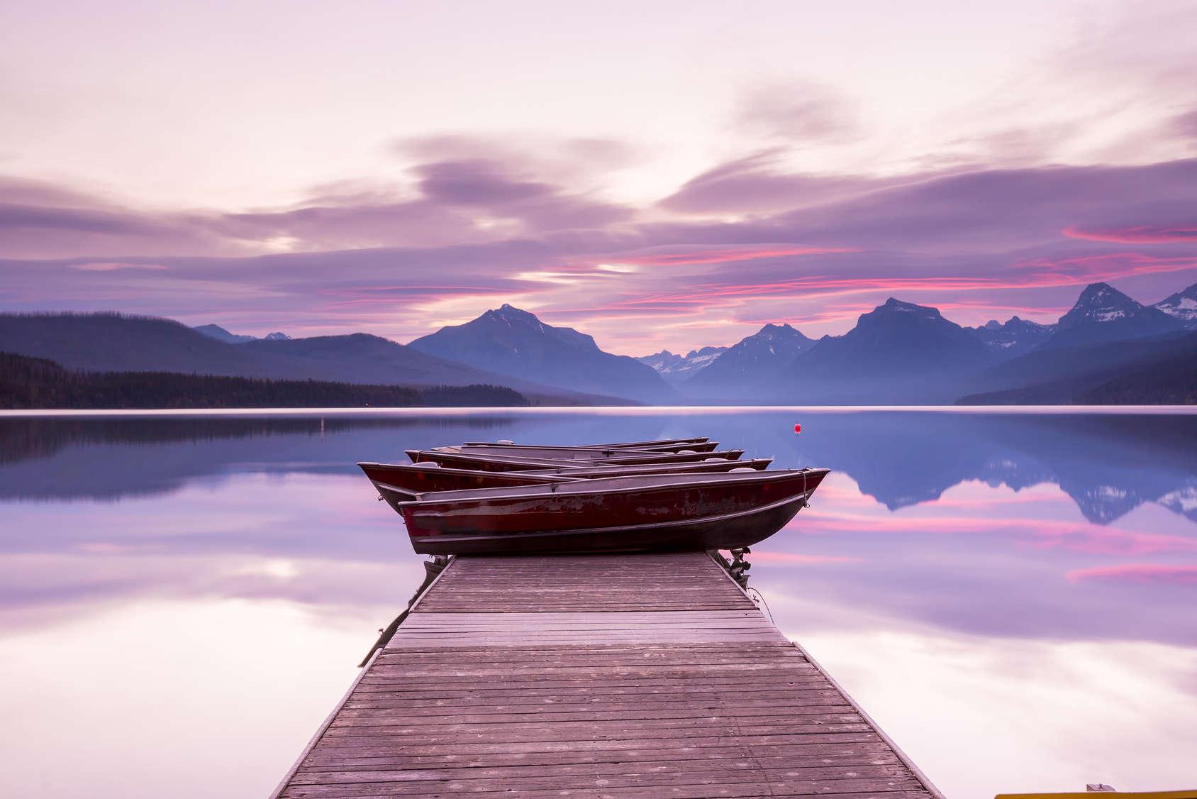 Boats sit on the dock at Lake McDonald at twilight. Glacier National Park, Montana.